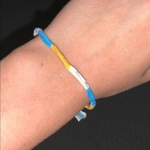Blue, orange, and white bracelet
